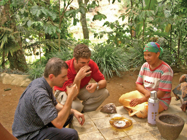 Prof. Marcone and Alun trying kopi luwak in an Indonesian village.